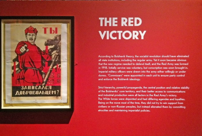 Russian Revolution, exhibition at the British Library, Red Army recruitment poster and wall text.wall text